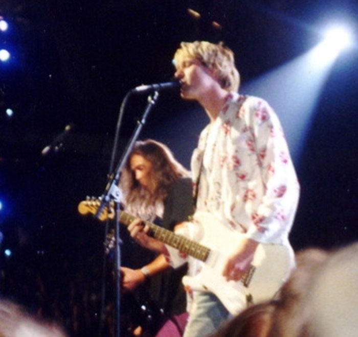 Kurt Cobain playing with Nirvana around 1992 - this image is from the Wikimedia Commons and the copyright is in the public domain.